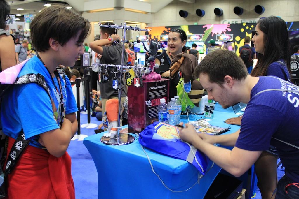 Dan autographing a fan's Pit People bag
