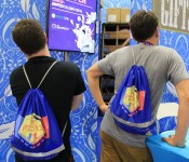 Co-founders of Behemoth (left to right), Dan Paladin & John Baez, model the Pit People bags (PAX West drawstring bags style may vary)